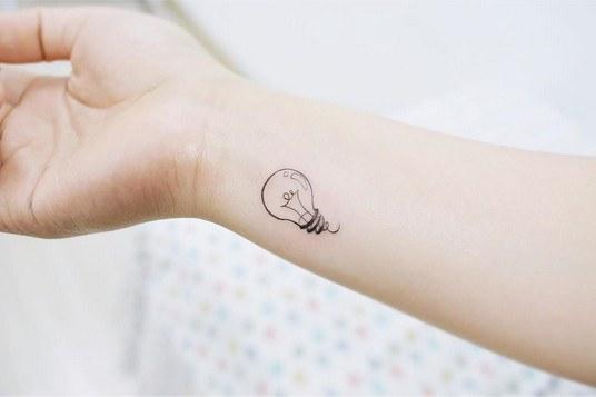 small lump tattoo on wrist