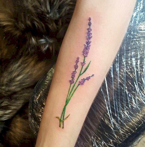 flower dainty feminine tattoos on arm