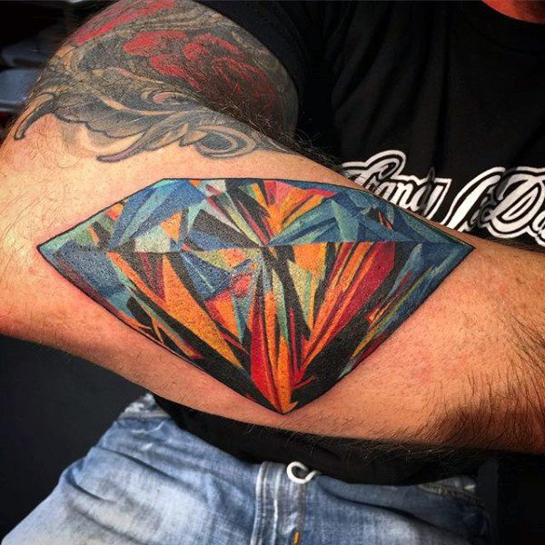 colorful diamond tattoo on elbow male