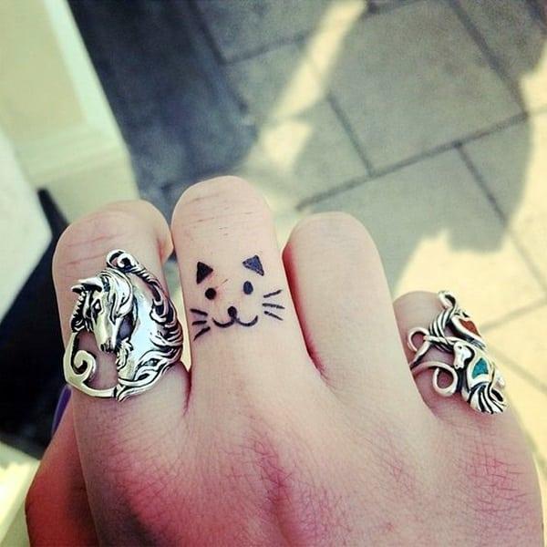 elegant cat tattoo on finger for you