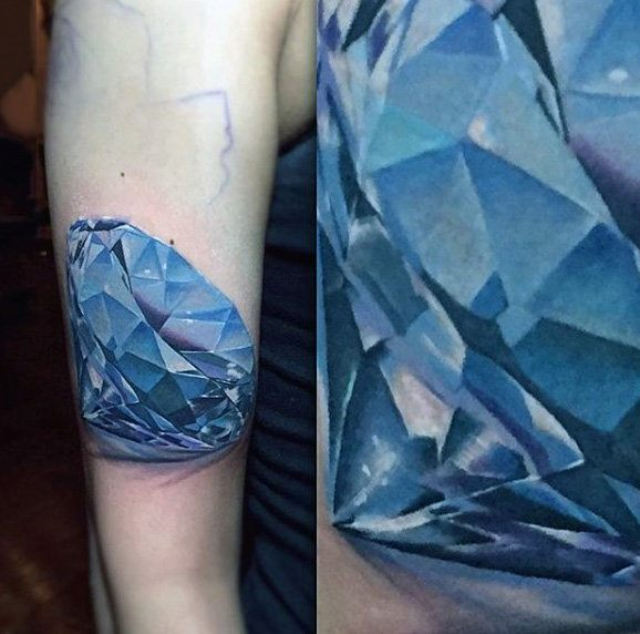 colored diamond tattoo on arm