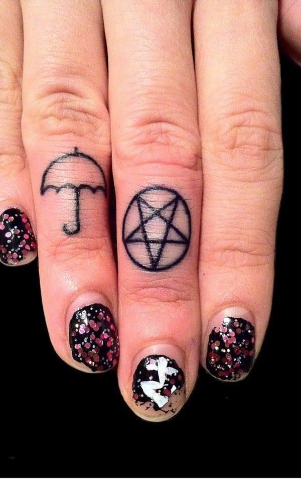 black symbol finger tattoo images