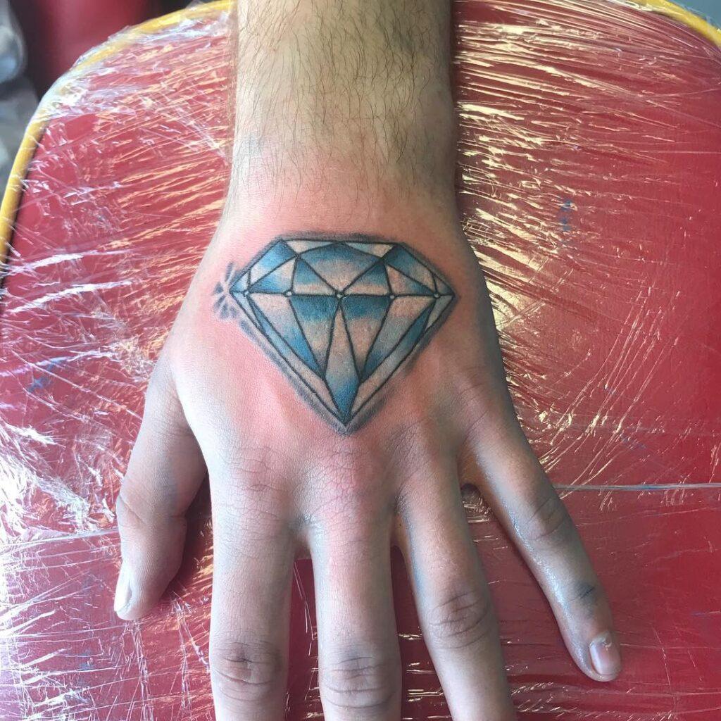 minimal diamond tattoo on hand