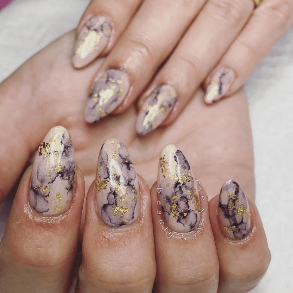 Classy marble nails for this lady