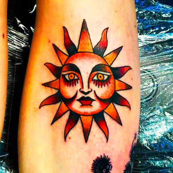 symbolism of sun and moon tattoo on arm