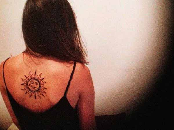 tribal sun design on back picture