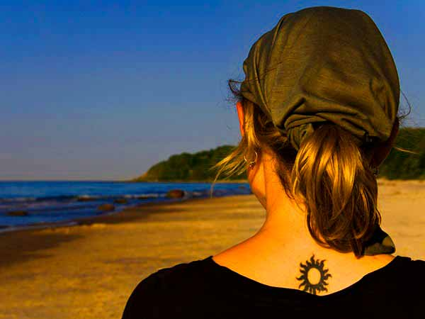 geometric sun  tattoo on back neck design images