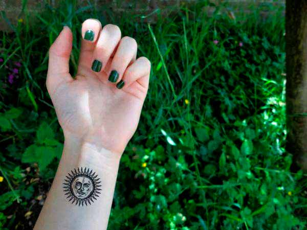 arm feminine sun tattoo images