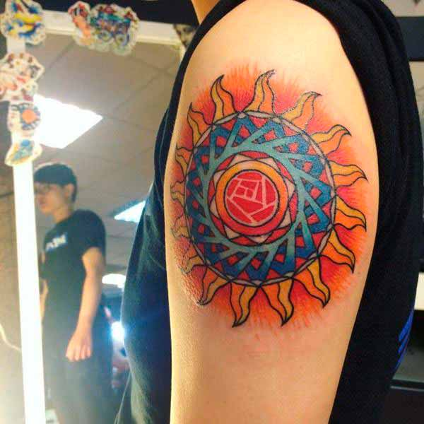 large sun tattoo cover up design on men shoulder
