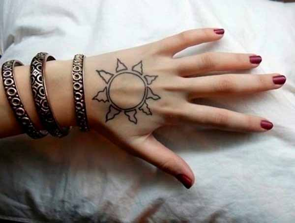 black simple sun tattoo design on hand