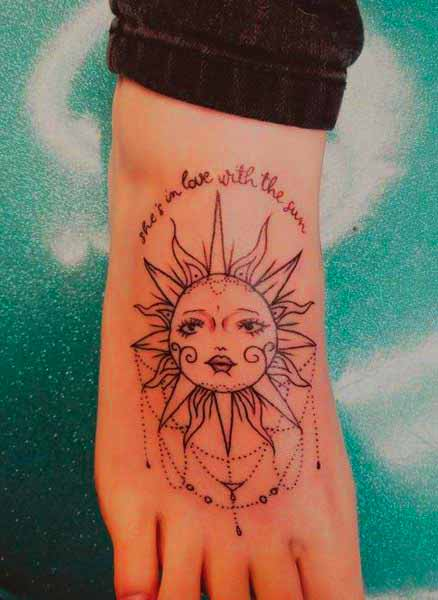 sun salutation tattoo on foot