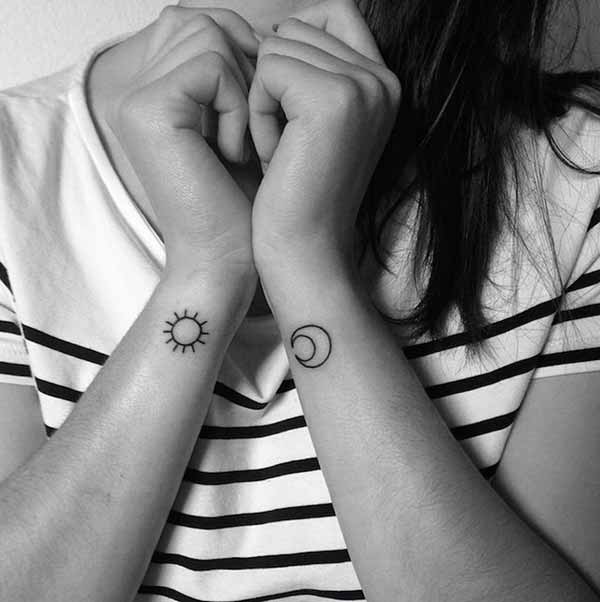 black small sun moon tattoo on women wrist