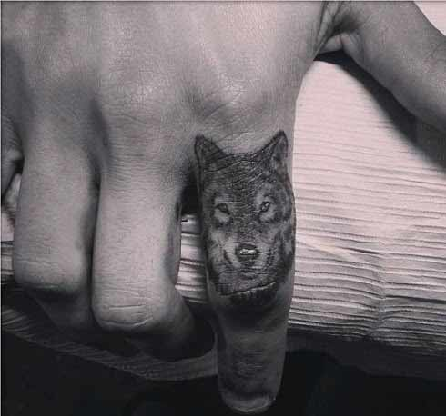 small wolf finger tattoo design