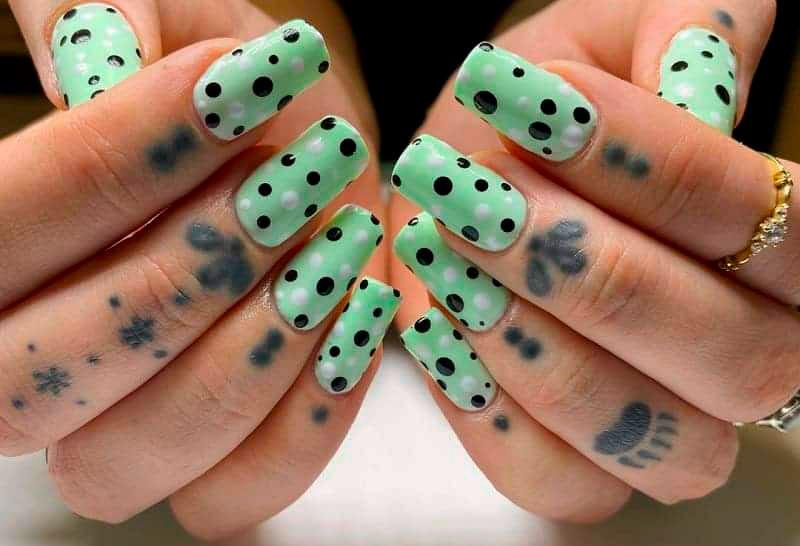mint acrylic nails spot design
