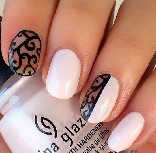 white nails with black design