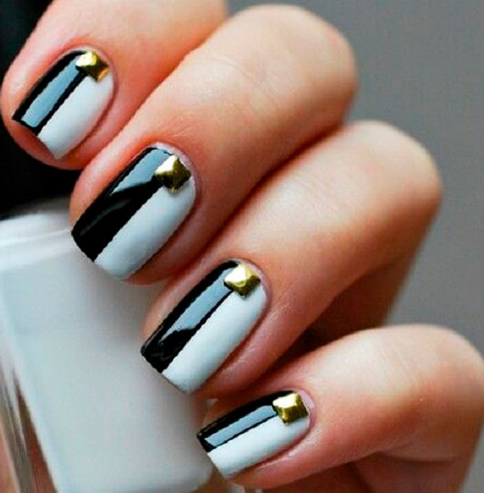 black white and gold nails