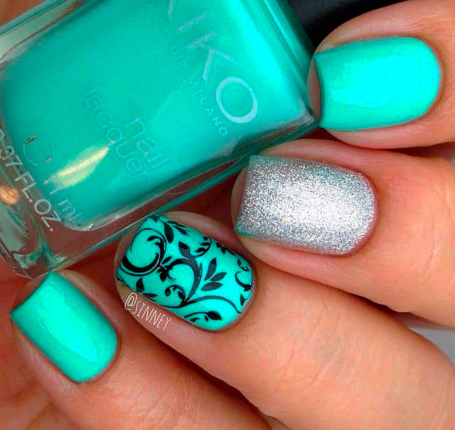 mint green nails with designs