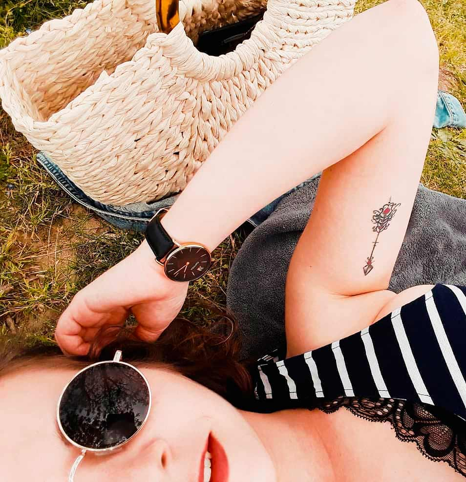 small arrow arm tattoos for girls and women