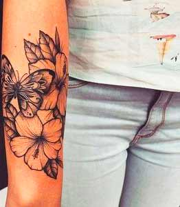 butterfly and flower tattoo on arm for women and girls