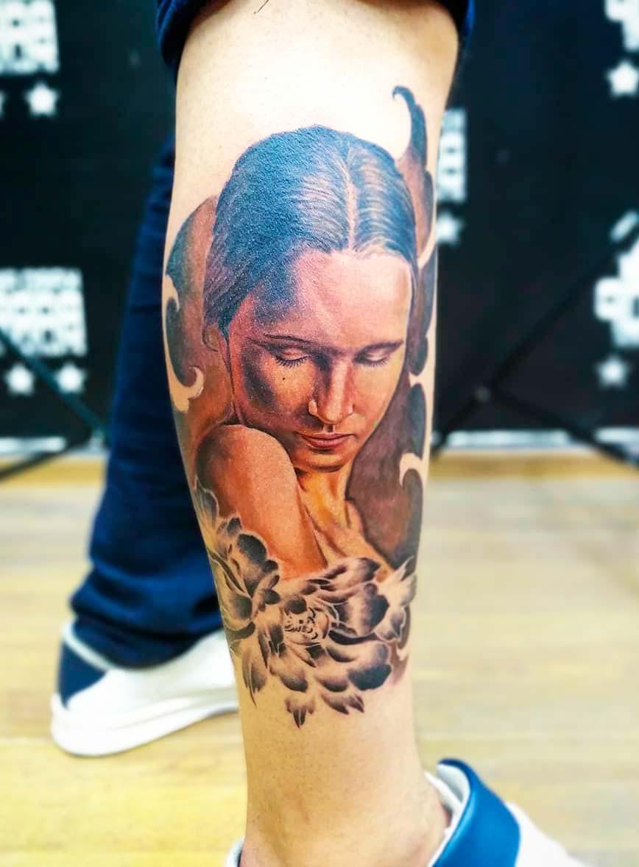 Elegant woman  Portrait Tattoos Designs On men leg
