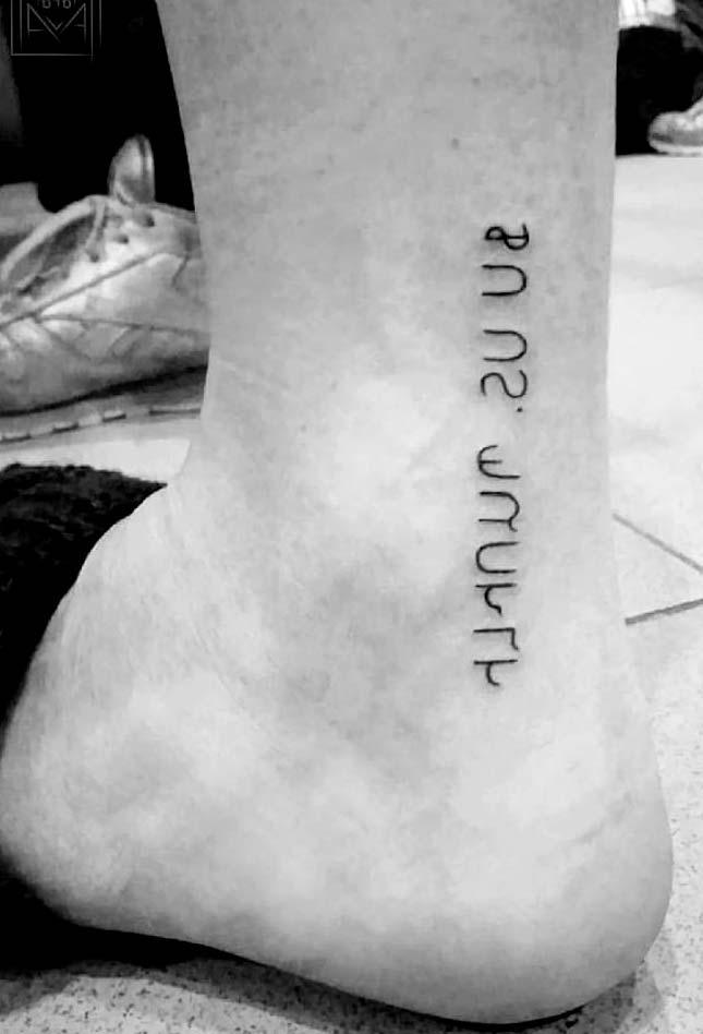 Unique letter Tattoos on men