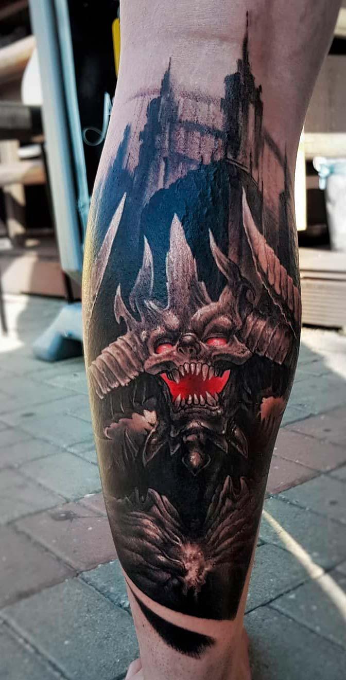 dragon tattoo design colored on leg for men