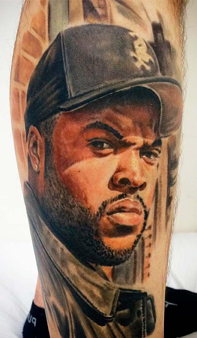 movie artist face tattoo on leg